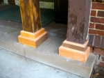 New wood on the front porch column bases.